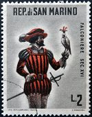 SAN MARINO - CIRCA 1961: A stamp printed in San Marino dedicated to hunting shows Mounted falconer