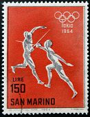SAN MARINO - CIRCA 1964: A stamp printed in San Marino shows fencing