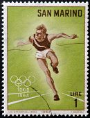SAN MARINO - CIRCA 1964: A stamp printed in San Marino shows athlete running