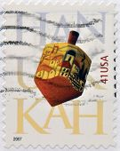 UNITED STATES OF AMERICA - CIRCA 2007: A stamp printed in USA dedicated to Hanukkah shows Dreidel