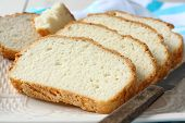 pic of fresh slice bread  - Fresh from the oven sliced gluten free bread on plate - JPG