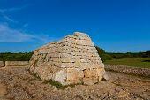 Menorca Ciutadella Naveta des Tudons megalithic chamber tomb In Balearic islands