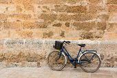 Bicycle in historical Ciutadella stone wall at Balearic islands