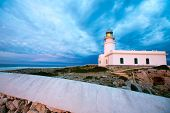 stock photo of faro  - Menorca sunset in Faro Far de Caballeria Lighthouse at Balearic Islands es Mercadal - JPG