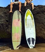 Two Friend Surfer Sitting On Rock