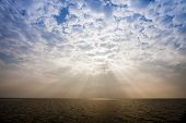 picture of sea-scape  - Sunbeam through the haze on the sky over the sea - JPG