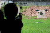 stock photo of shooting-range  - Shooting gun at field for practice  background - JPG