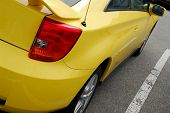Yellow sports car, rear view