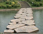 Stone Bridge In Beautiful Garden