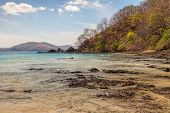 stock photo of papagayo  - Scenic view of the rocky beach along the Golfo de Papagayo in Guanacaste Costa Rica - JPG