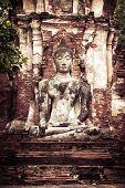 Ancient sandstone sculpture of Buddha at Wat Mahathat ruins. Ayutthaya Thailand