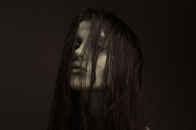 stock photo of possession  - Close up portrait of a evil woman possessed by the devil - JPG