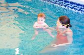 Cute Little Baby In An Early Swimming Class
