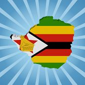 Zimbabwe map flag on blue sunburst illustration