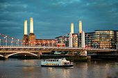 LONDON, UK - SEP 27: Battersea Power Station and bridge in Thames River on September 27, 2013 in Lon