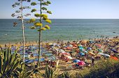 ALGARVE, PORTUGAL - JULY 22nd 2014: Vacationers in Pera Beach, in Algarve on July 22nd, 2014. Algarve is a major Summer destination for mostly British tourists, with nearly 500.000 accommodations.