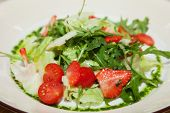 fresh salad with cherry tomatoes and strawberries