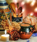 foto of chocolate spoon  - Jar of hot chocolate and sweet bread pan de muerto with wooden chocolate grinder and spoons on festive background - JPG