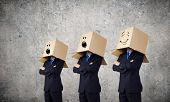Unrecognizable business people with carton boxes on head
