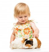 stock photo of baby pig  - Little cute baby girl with guinea pigs - JPG