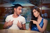 stock photo of conflict couple  - Young adult couple arguing with funny expressions and gestures - JPG