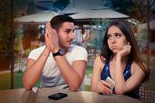 Young Couple Having Problems with Their Smart Phones