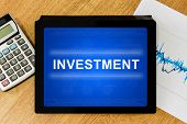 Financial Investment Word On Digital Tablet