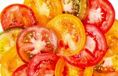 Big Abstract Background Of Healthy Natural Food Different Color Tomato Slices, Fresh Organic Food