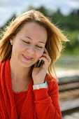 Beautiful caucasian girl talking to phone