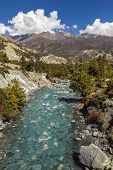 Mountain River In Himalayas, Annapurna Circuit Trail In Nepal.