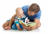 Kid Boy And His Father Read A Book