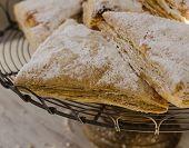 Flakey pastries on rack