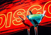 Blue And Red Cocktail With Neon Disco Word Background With Space For Text