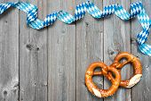 picture of pretzels  - Bavarian pretzels with ribbon on wooden board as a background for Oktoberfest - JPG
