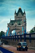 Tower Bridge closeup with vintage taxi in London.