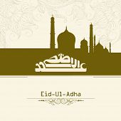 Arabic islamic calligraphy of text Eid-Ul-Adha with green mosque on floral design decorated background.