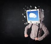 Business man with a monitor on his head, cloud system and pointers on the screen on a dark backgroun