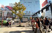 Tokyo, Japan - November 24, 2013: People Walk By Store Building On Omotesando Street