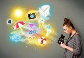 Beautiful teenage photographer making photos of holiday painted icons