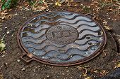 picture of manhole  - Cast iron manhole from the well in the underground comunications - JPG