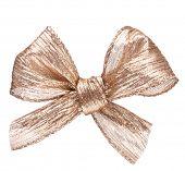 Festive gold gift  bow isolated on white background