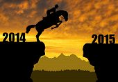 stock photo of horse-riders  - The rider on the horse jumping into the New Year 2015 - JPG