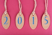 New year tags on pink background