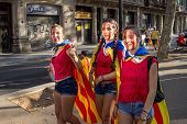 Teenagers Manifesting Ingependence On The Strret Of Barcelona