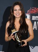 LOS ANGELES - APR 13:  Mila Kunis in the 2014 MTV Movie Awards - Press Room  on April 13, 2014 in Lo