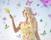 Blond beauty and butterflies