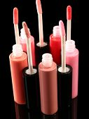 Beautiful lip glosses on dark background