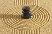 stock photo of yin  - Japanese garden with rocks in sand and yin and yang - JPG