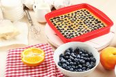 Baking tasty pie and ingredients for it on table in kitchen