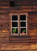 Wooden house facade with window